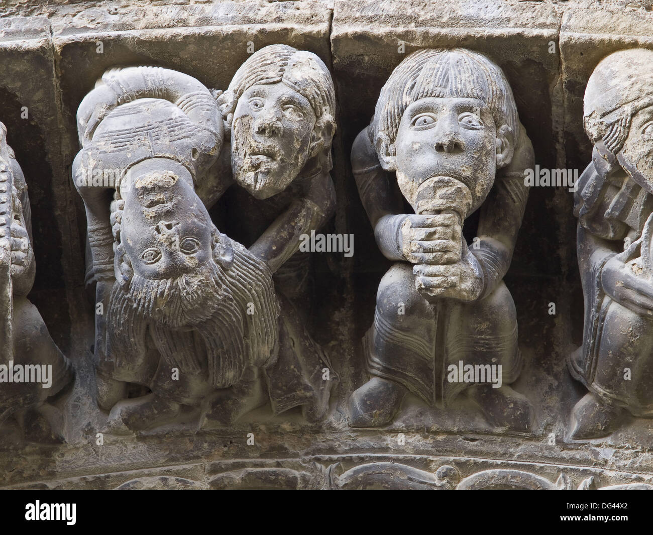 Voussoirs carved with depictions of a musician playing flute and two acrobats, Romanesque church of Santa Maria (12th century), - Stock Image