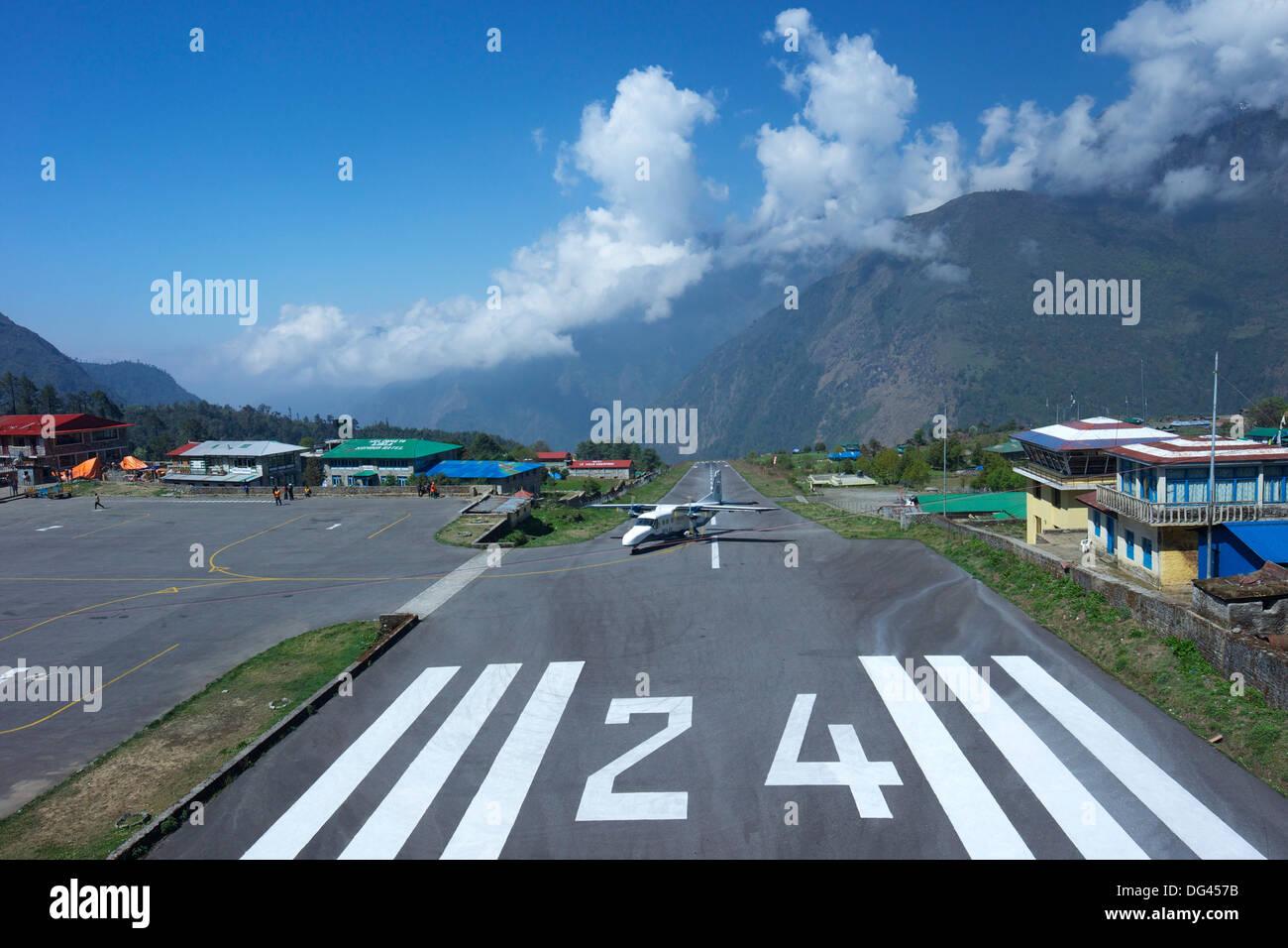 Sita Air Dornier 228 airplane landing on runway, Tenzing-Hillary Airport, Lukla, Nepal, Asia - Stock Image