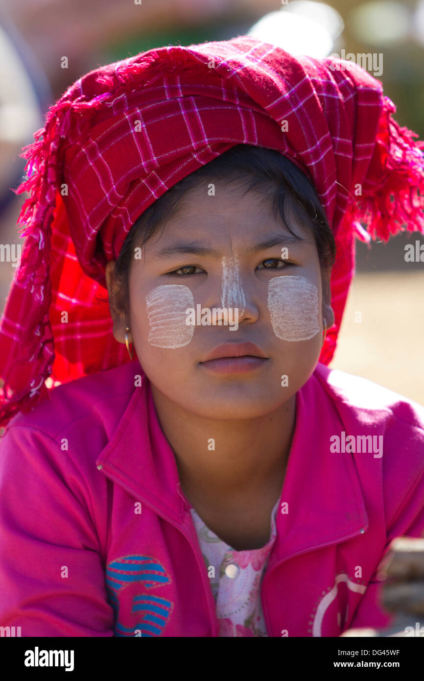 Young Pa-O tribe woman wearing traditional Thanaka sun block paste, Thaung Tho tribal market, Inle Lake, Shan State, Stock Photo