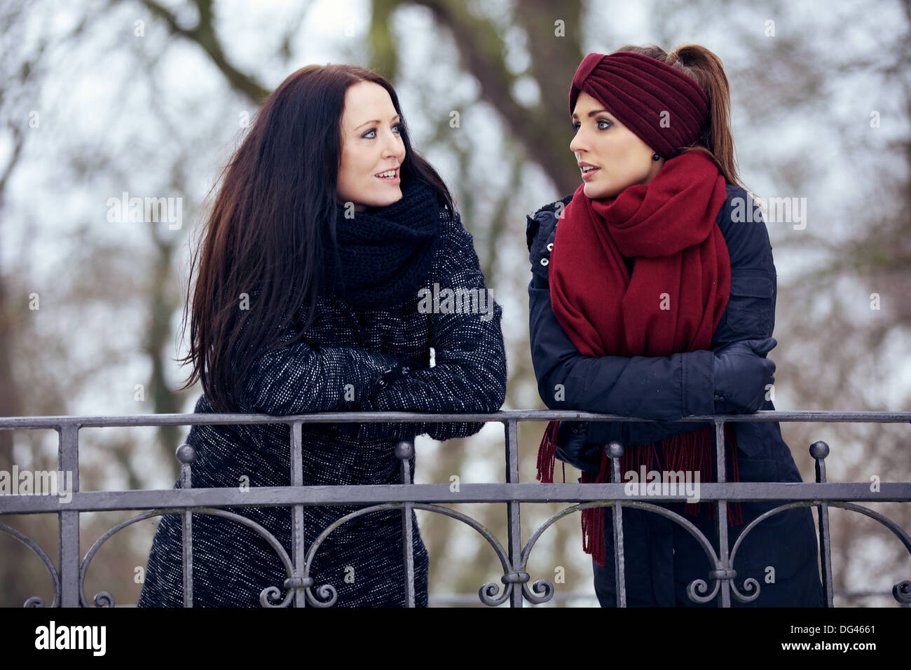 Relaxed women in the park having a serious conversation - Stock Image