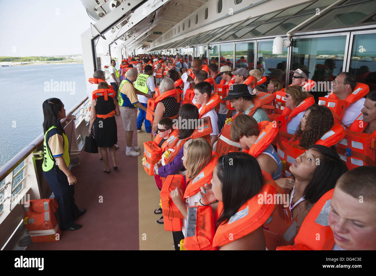 Cruise passengers participate in mandatory Muster Station drill prior to leaving the port at Cape Canaveral, Florida, USA - Stock Image