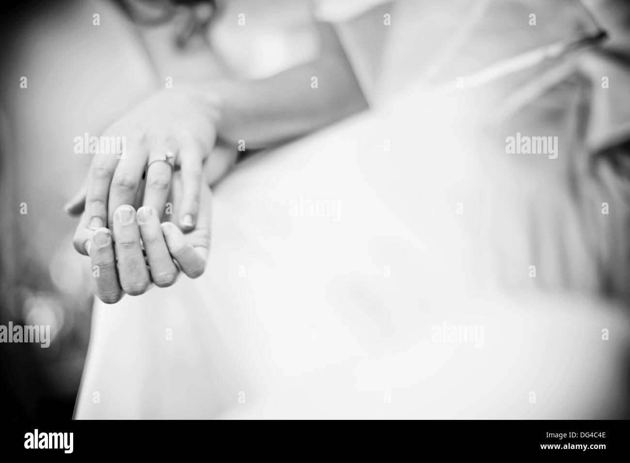 wedding ring, hands together - Stock Image