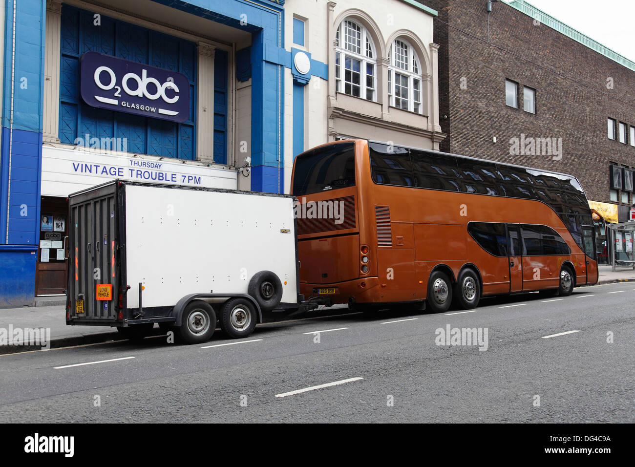 Tour bus outside the O2 abc where Blues Band Vintage Trouble performed, Sauchiehall Street, Glasgow city centre, Scotland, UK - Stock Image