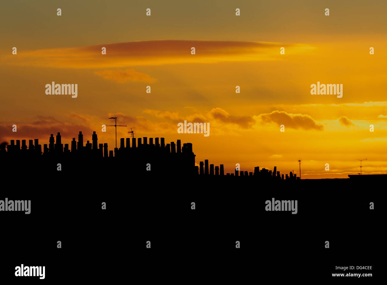Silhouette of chimney pots at sunset, Scotland, UK - Stock Image