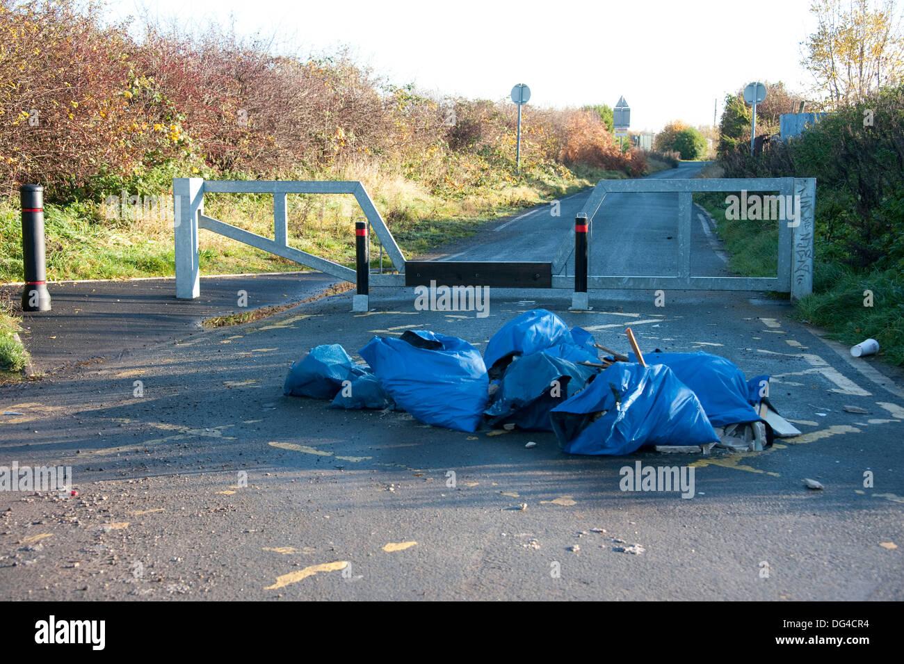 Hazardous waste Asbestos fly tipping illegal - Stock Image