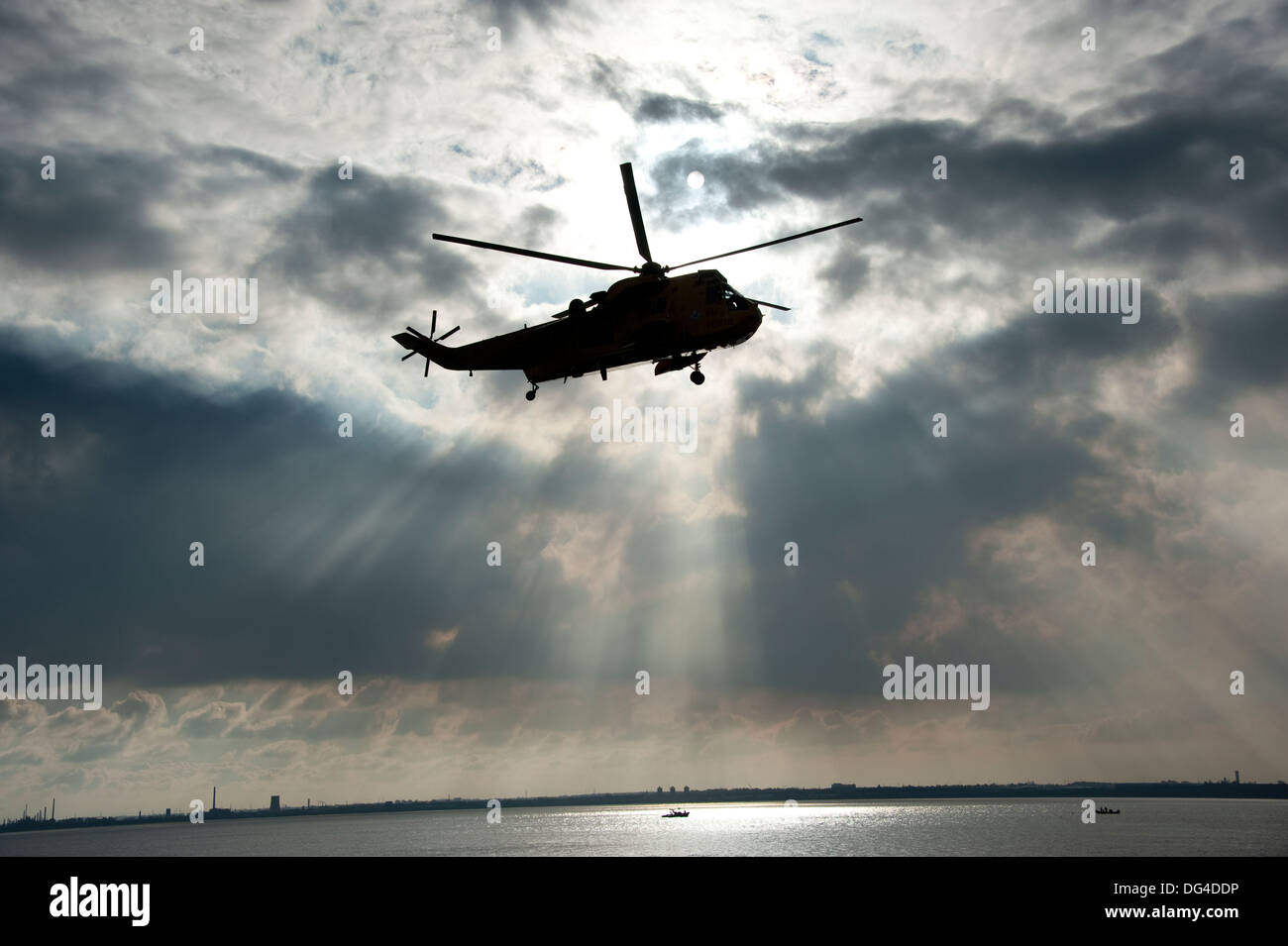 Seaking helicopter rescue dark foreboding sky - Stock Image