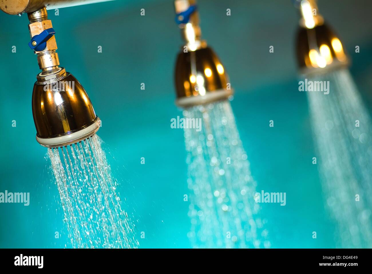 Thee showers falling water in a SPA - Stock Image