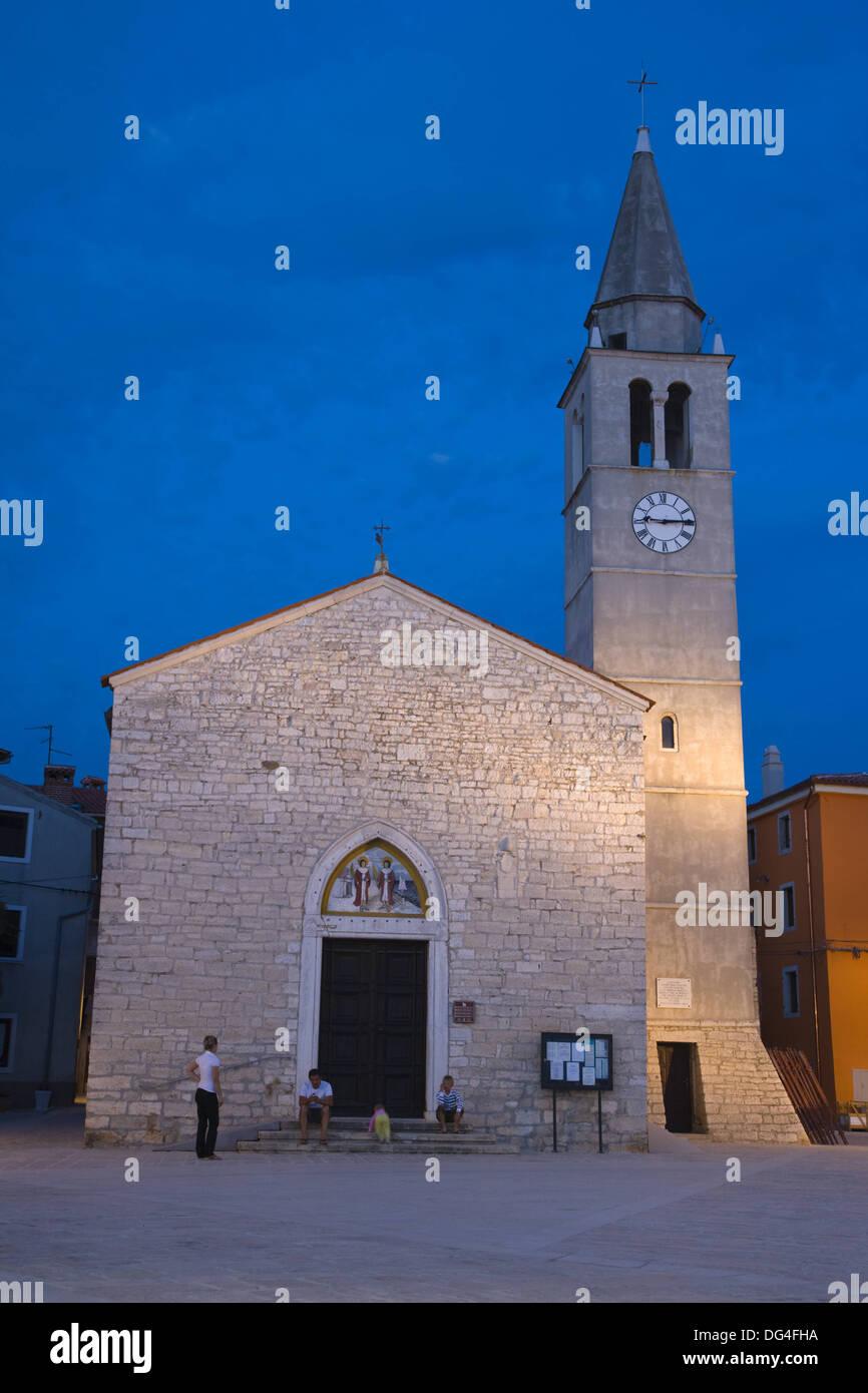 Church of Sts Cosmas and Damian at twilight, Titova Riva, Fazana, Istria, Croatia - Stock Image