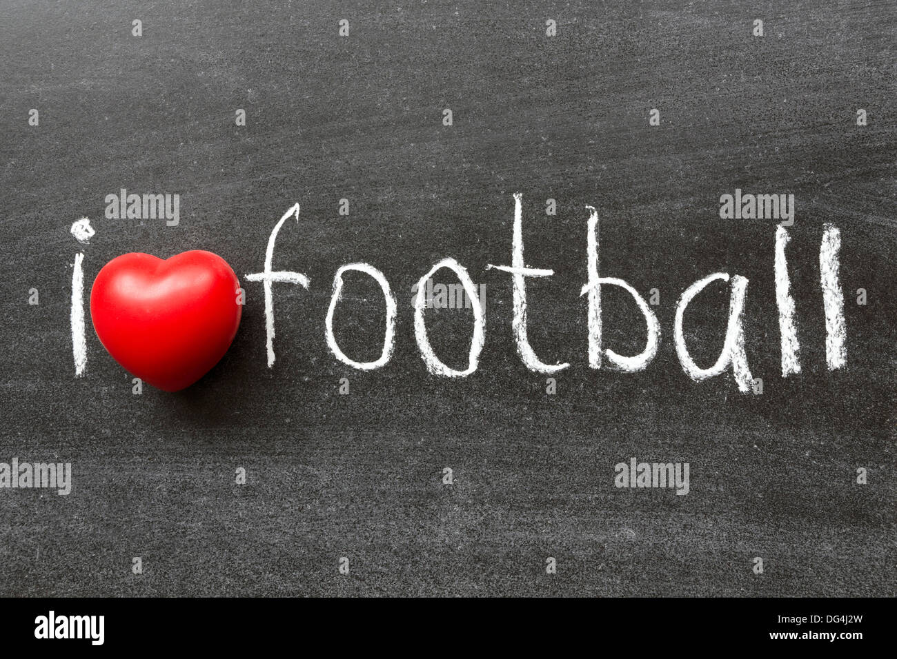 I love football phrase handwritten on the school blackboard - Stock Image