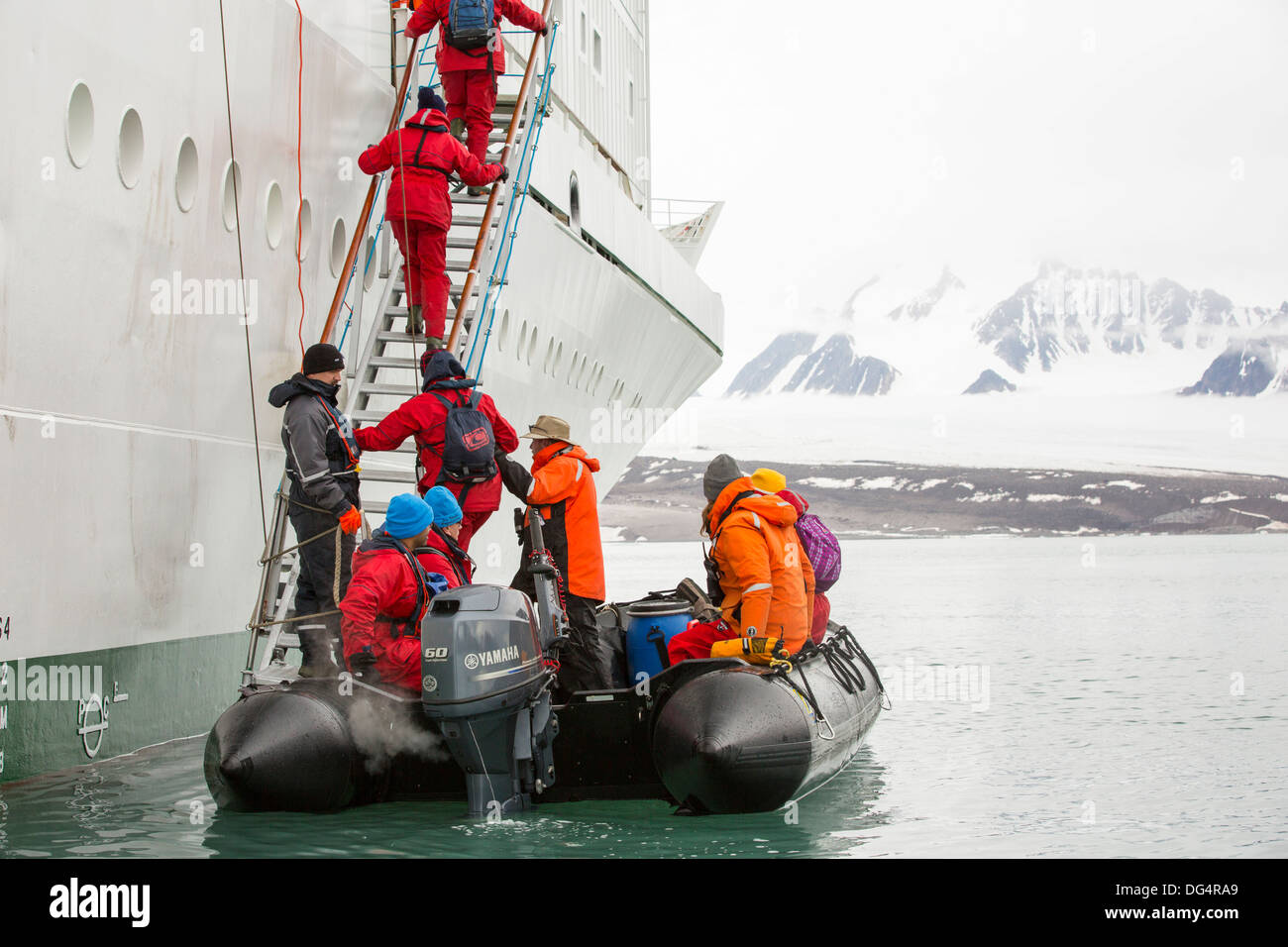 Passengers disembark Zodiaks onto the Russian research vessel, AkademiK Sergey Vavilov an ice strengthened ship - Stock Image