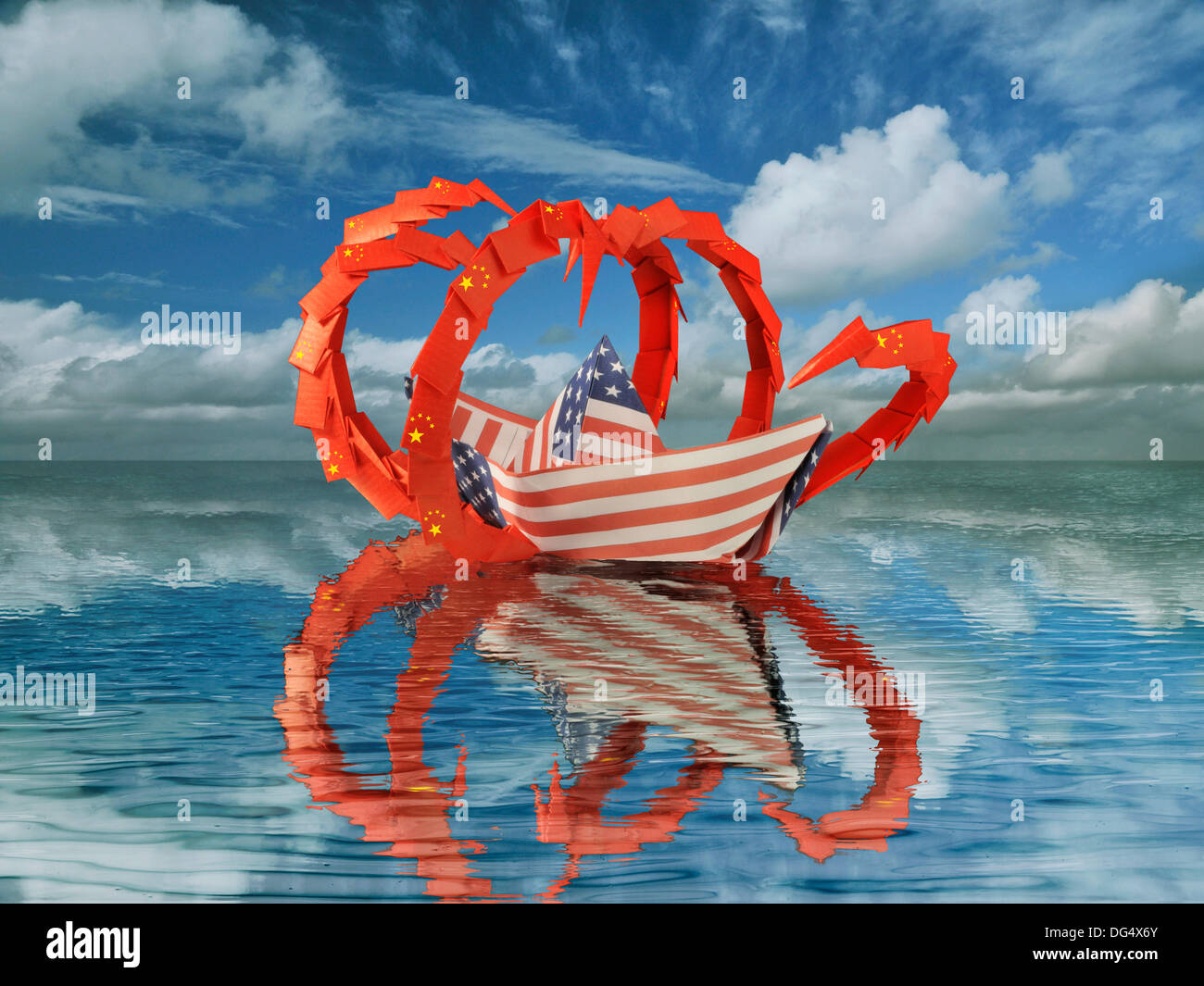 A paper boat made of the flag of the USA is attacked by a sea monster with the pattern of the Chinese flag. - Stock Image