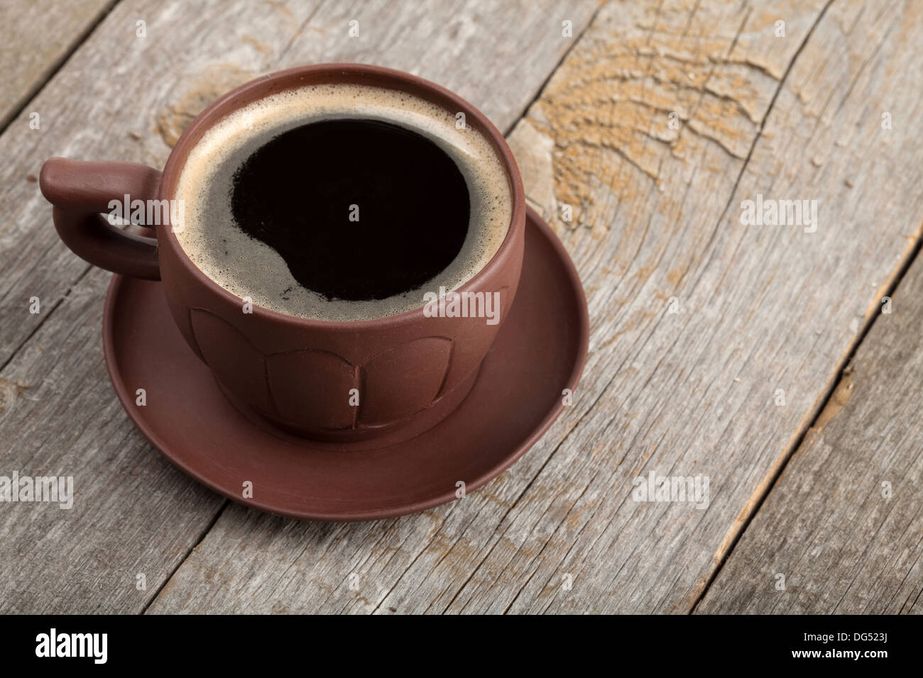 Coffee cup with spices on wooden table texture - Stock Image