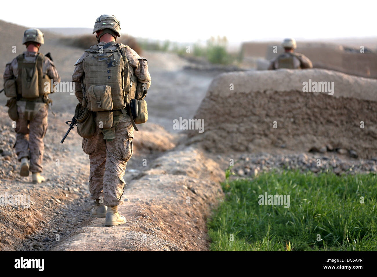 US Marines with Alpha company, 9th Marine Regiment during a foot patrol October 12, 2013 in Helmand province, Afghanistan. - Stock Image