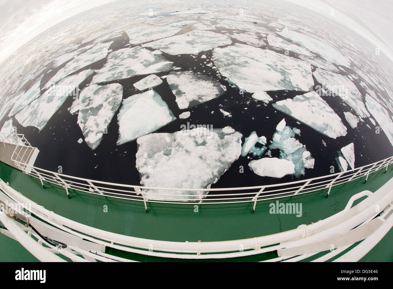 Rotten sea ice at over 80 degrees North off the north coast of Svalbard. Climate change is causing sea ice to retreat rapidly. - Stock Image
