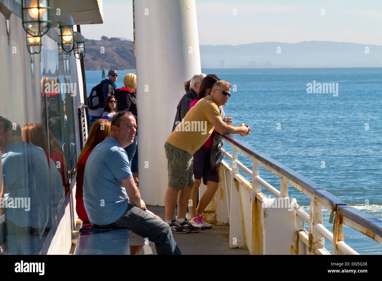 Sightseers riding the ferry from San Francisco to Sausalito. - Stock Image