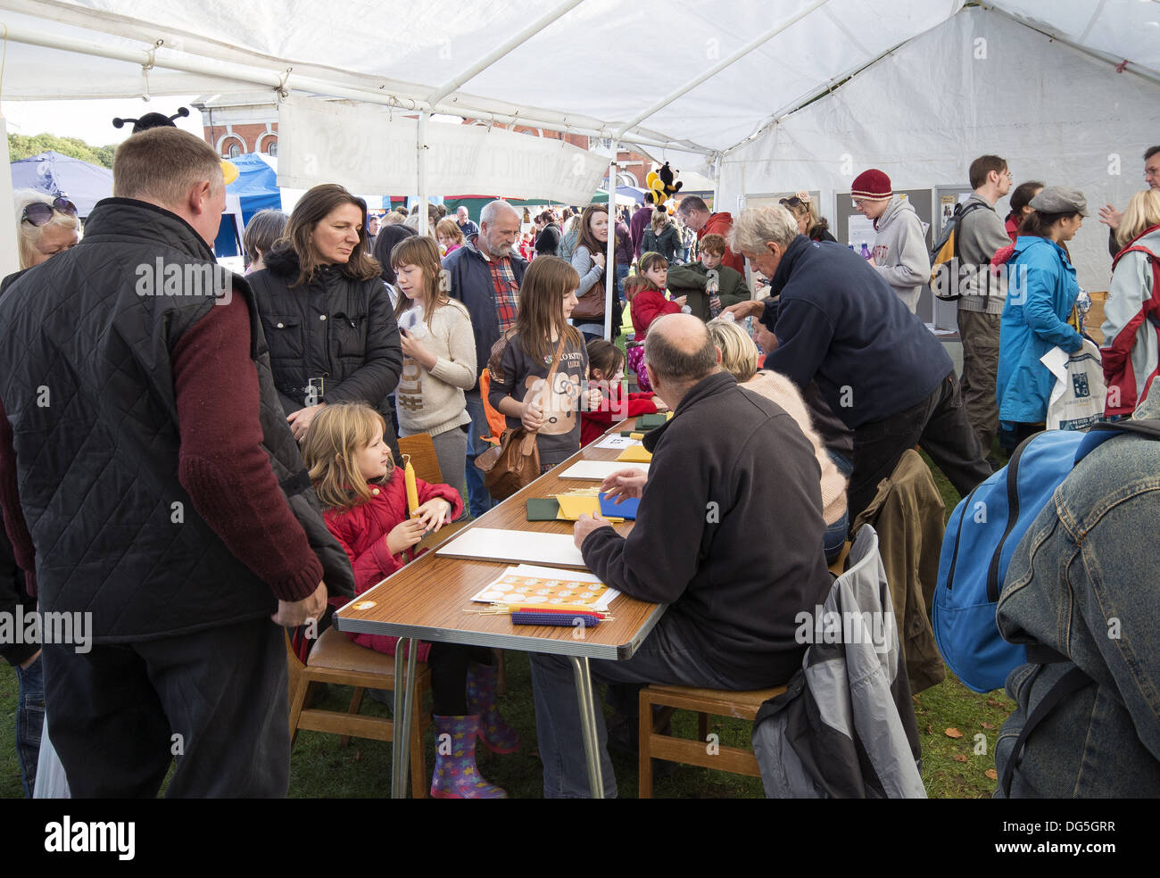 Beeswax candle making at the autumn pumpkin festival at the Royal Victoria Country Park, Netley, Southampton, Hampshire, England - Stock Image