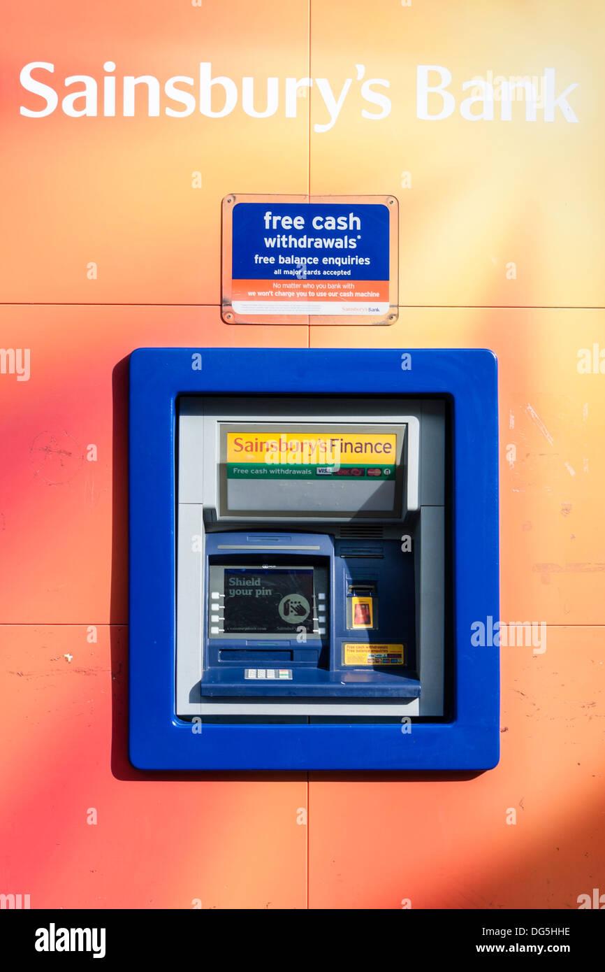 Sainsbury's bank. Automated cash machine outside branch of UK supermarket. - Stock Image