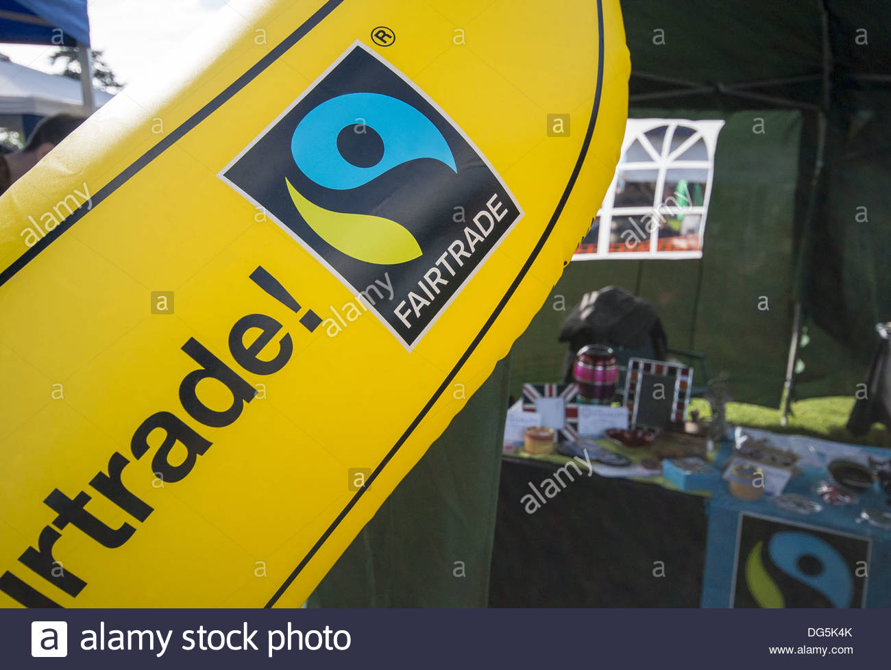 Fair Trade stall with inflatable banana showing the Fair Trade logo - Stock Image