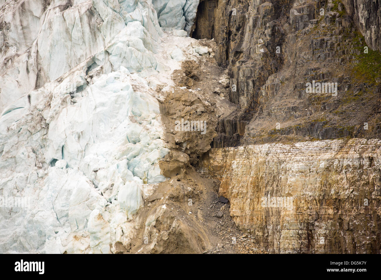 A glacier at Alkefjellet in northern Svalbard. At the side of the glacier is an unconformity where basalt rock has - Stock Image