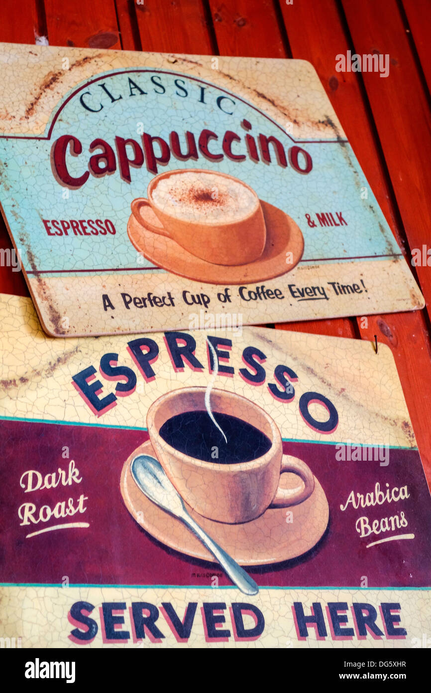Two Old Metal Coffee Ads on a Wall, Crete, Greece - Stock Image