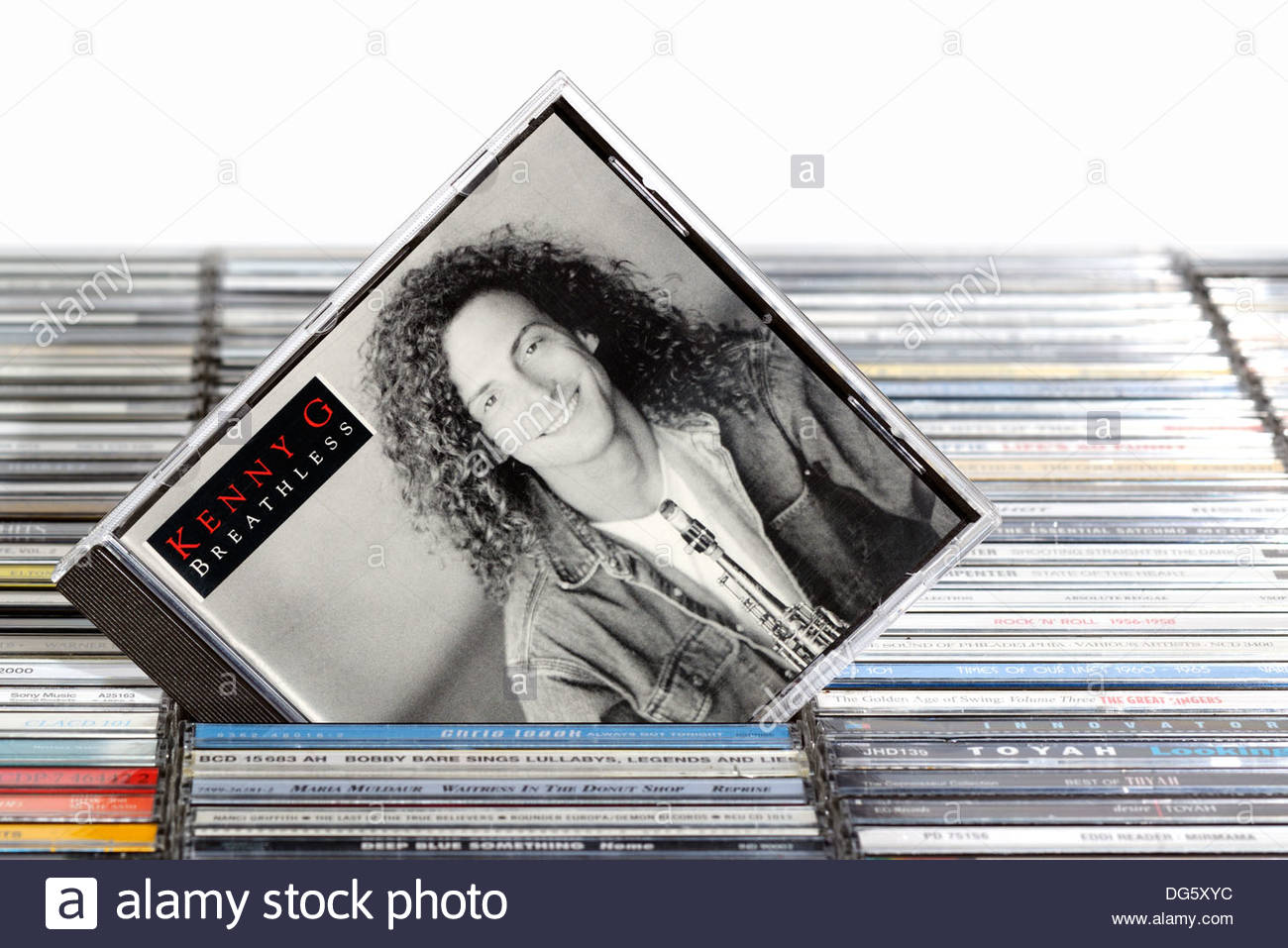 Kenny G album Breathless, piled music CD cases, England - Stock Image