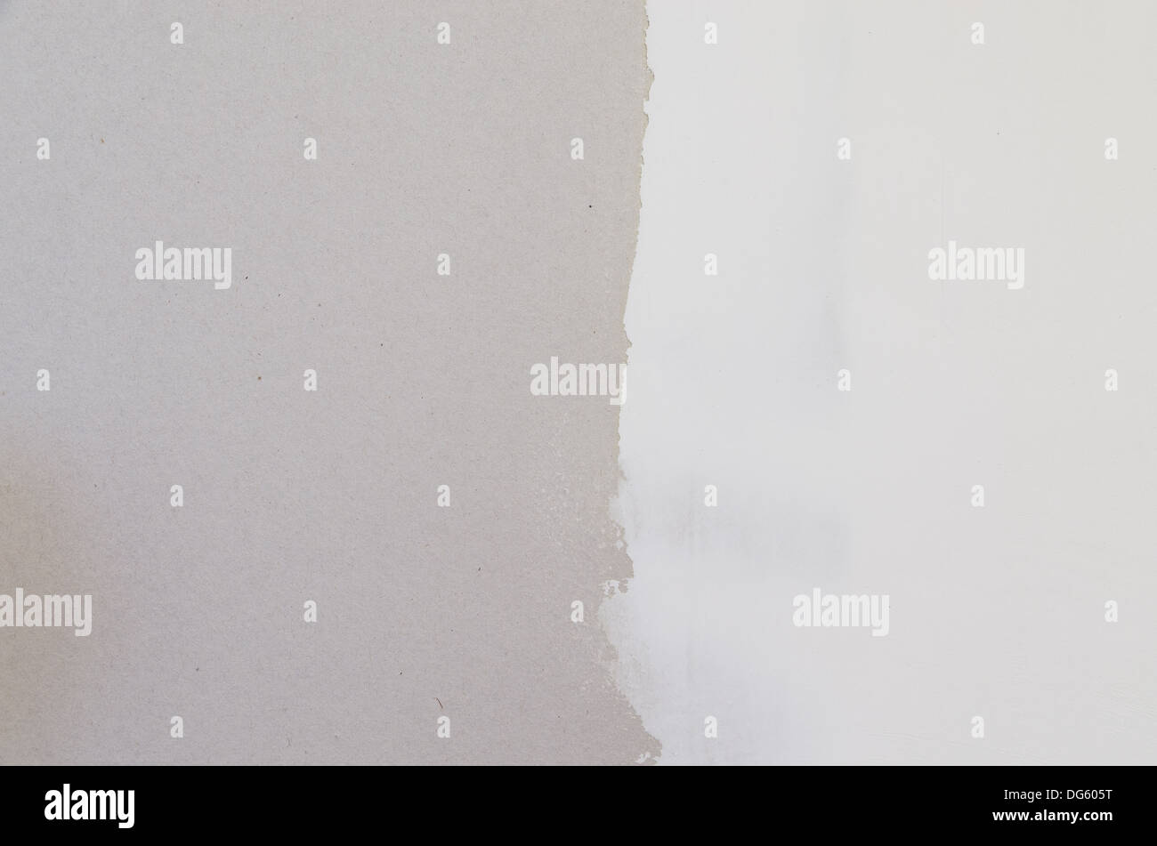 drywall with half covered with joint compound spackle background - Stock Image