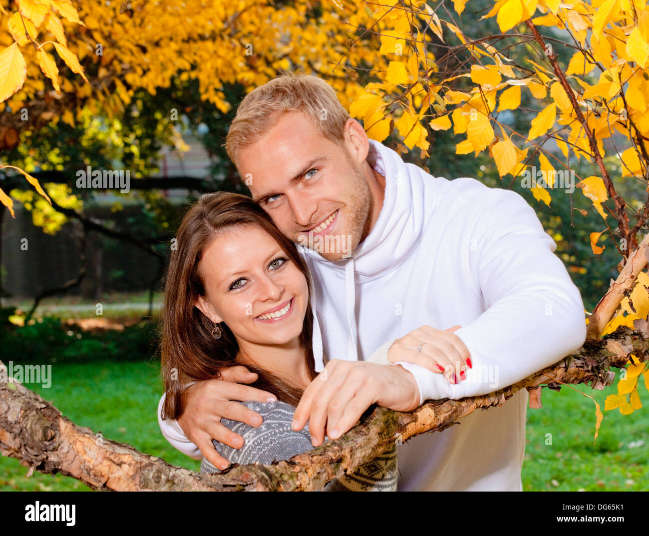 portrait of a happy young couple in the park, smiling. - Stock Image