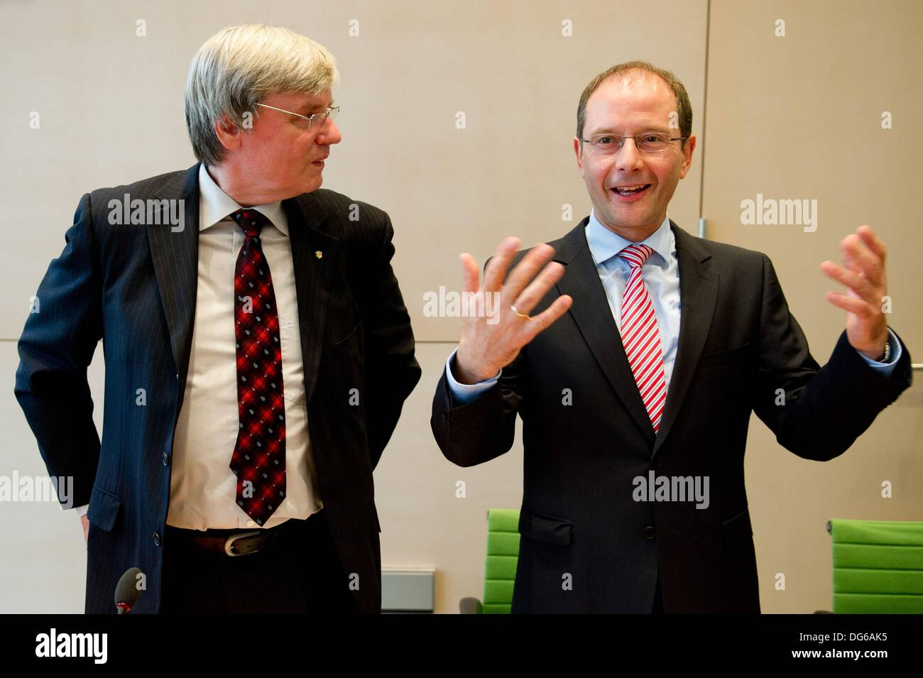 Dresden, Germany. 15th Oct, 2013. Chairman of the Saxon committee of the interior, Rolf Seidel (L), and Saxony's Minister of the Interior Markus Ulbig (CDU) arrive at a special meeting of the Saxon committee of the interior at the Saxon state parliament in Dresden, Germany, 15 October 2013. The special meeting was about the violent commotion at the refugee centre in Chemnitz three weeks ago. Photo: SEBASTIAN KAHNERT/dpa/Alamy Live News - Stock Image