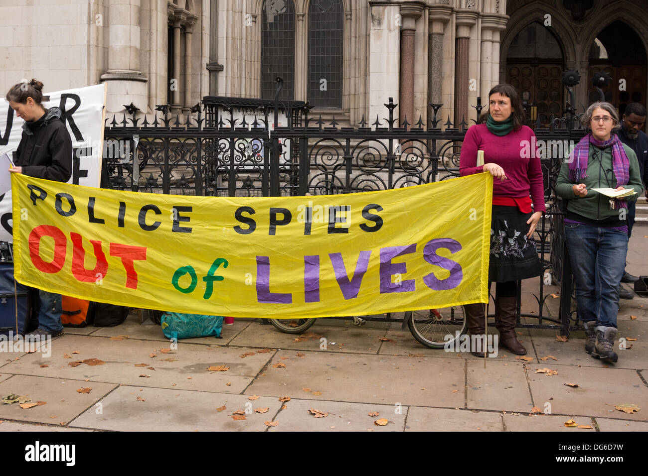 London, UK. 15th October 2013. Supporters of women taking legal action over the actions of police spies including Mark Kennedy and Marco Jacobs, picket outside the Court of Appeal, Royal Courts of Justice in London. The women, who unknowingly had relationships with undercover police infiltrating political movements during a period spanning from 1987 to 2011 are seeking to overturn a decision which directed that human rights legal actions over undercover police relationships should be heard in a secret court. Credit:  Patricia Phillips/Alamy Live News - Stock Image