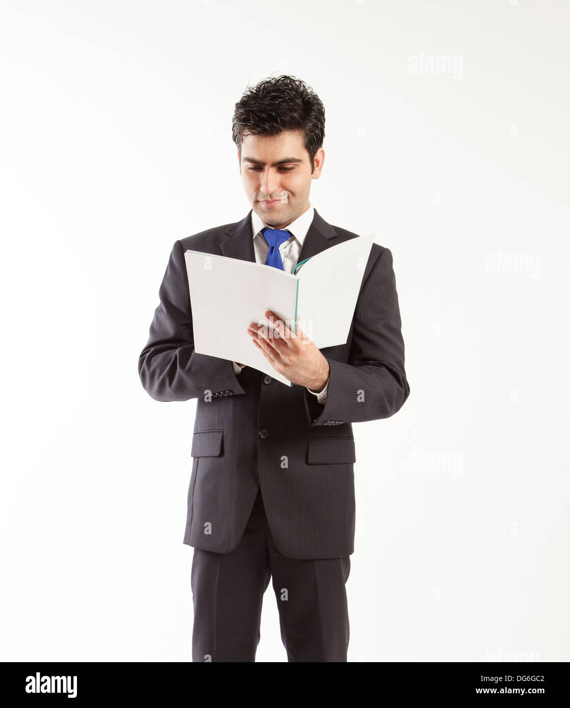 Bussiness man reading book - Stock Image