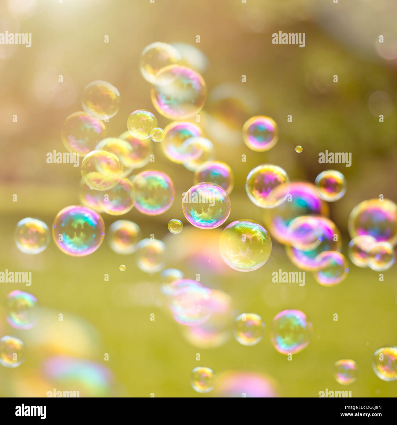 light bubbles drifting in a summer breeze. - Stock Image