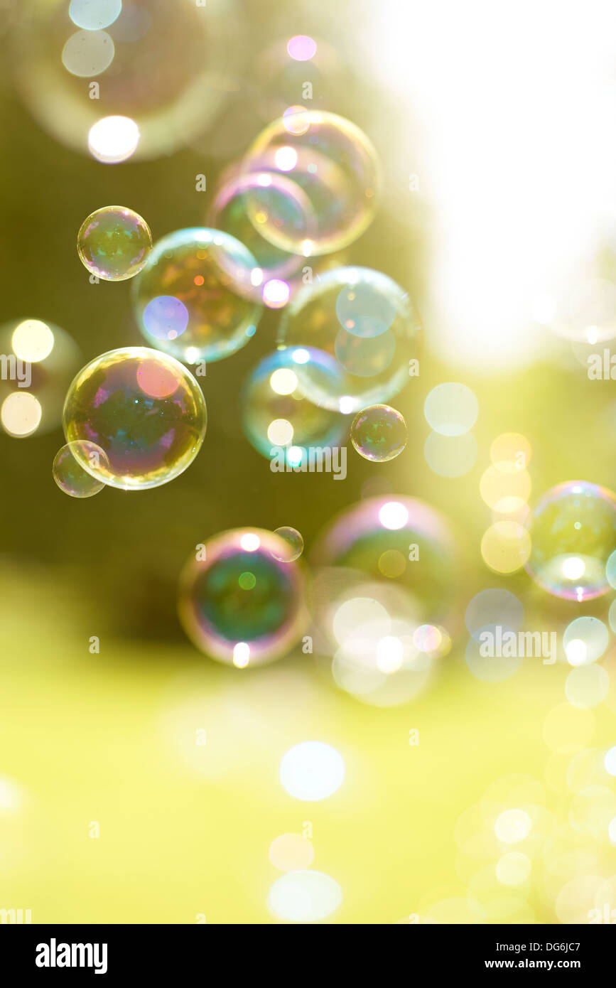 Bubbles drifting in a summer breeze. - Stock Image