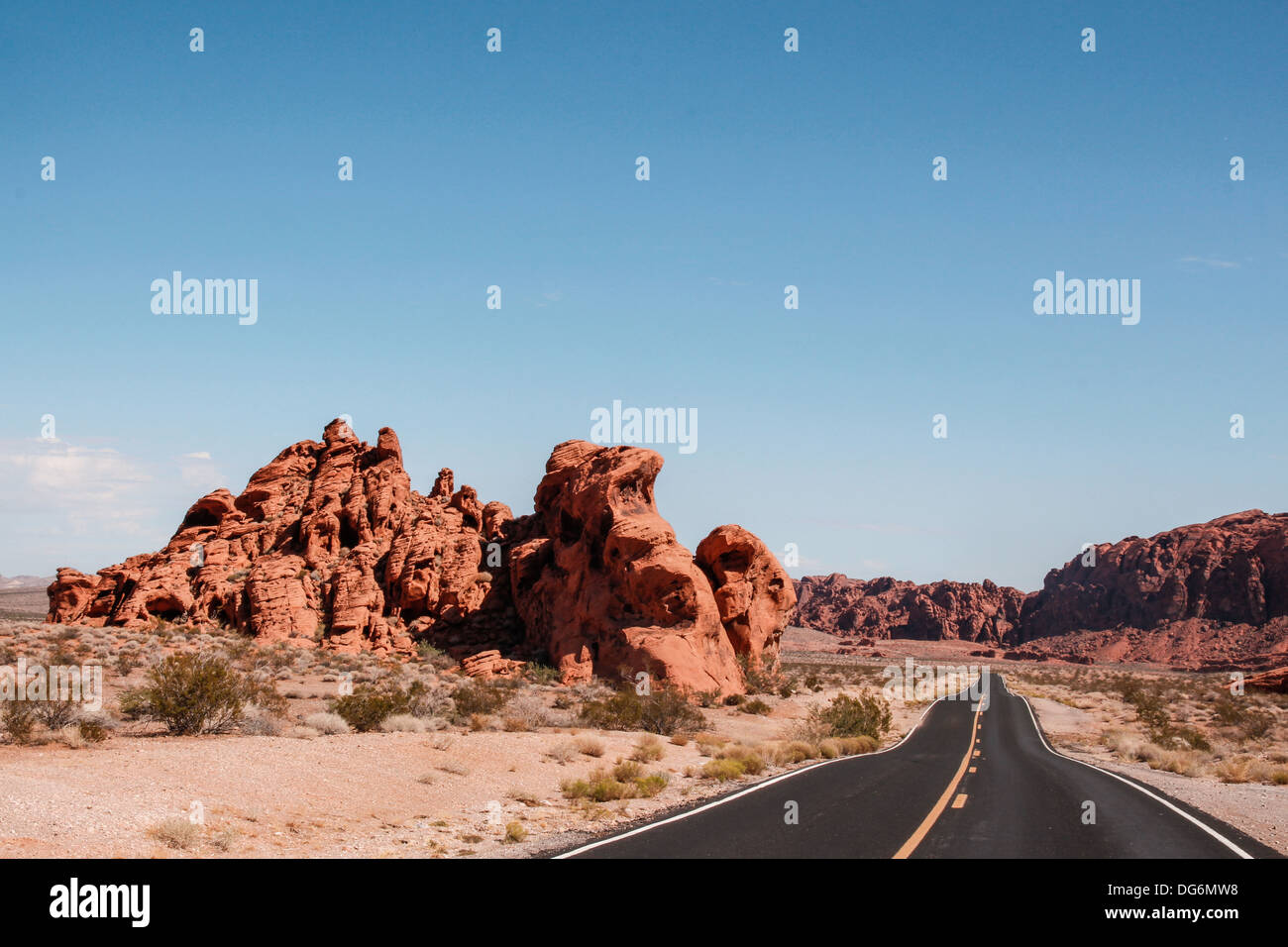 A desert road along a red rock - Valley of Fire, Nevada. - Stock Image