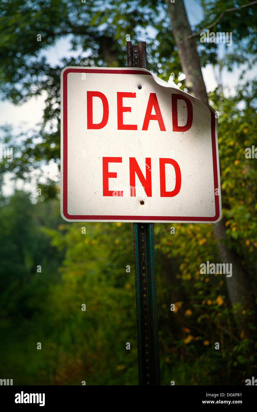 Bold red dead end sign marks the end of the road - Stock Image