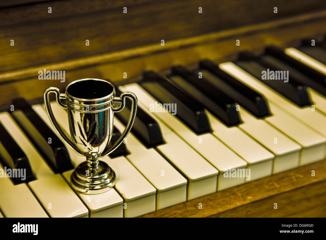 Small trophy cup on a piano keyboard Stock Photo: 61615805