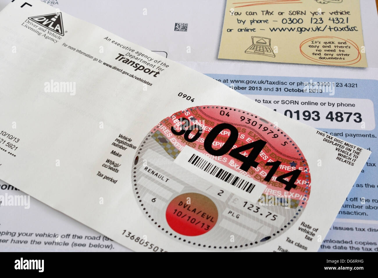 UK car tax disc and renewal form - Stock Image