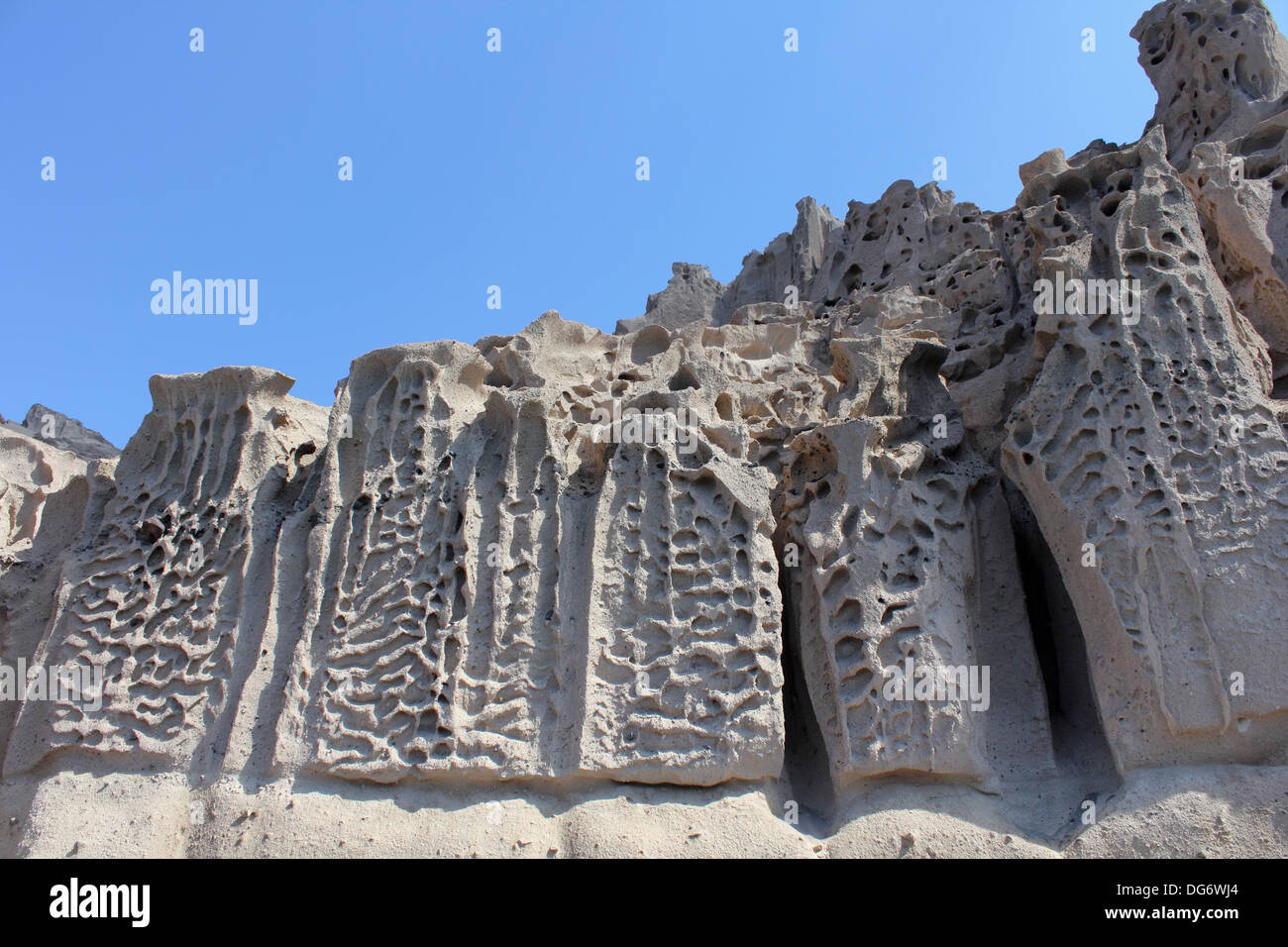 Pumice cliffs eroded by the wind - Vlychada, Santorini - Stock Image