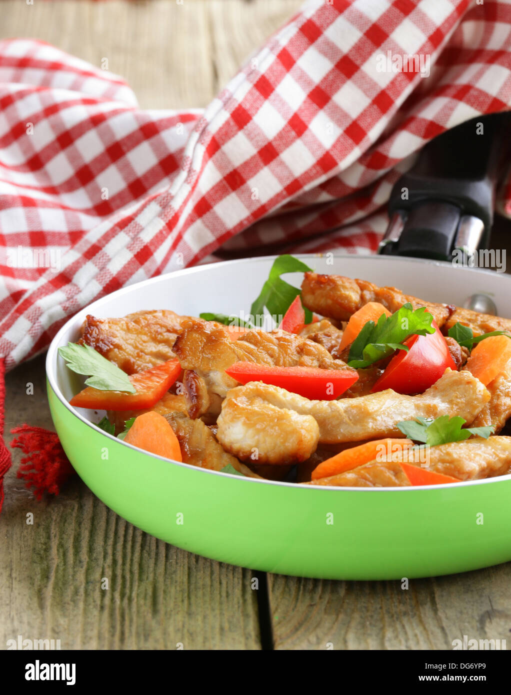 fried chicken (turkey) fillets with vegetables in a pan Stock Photo