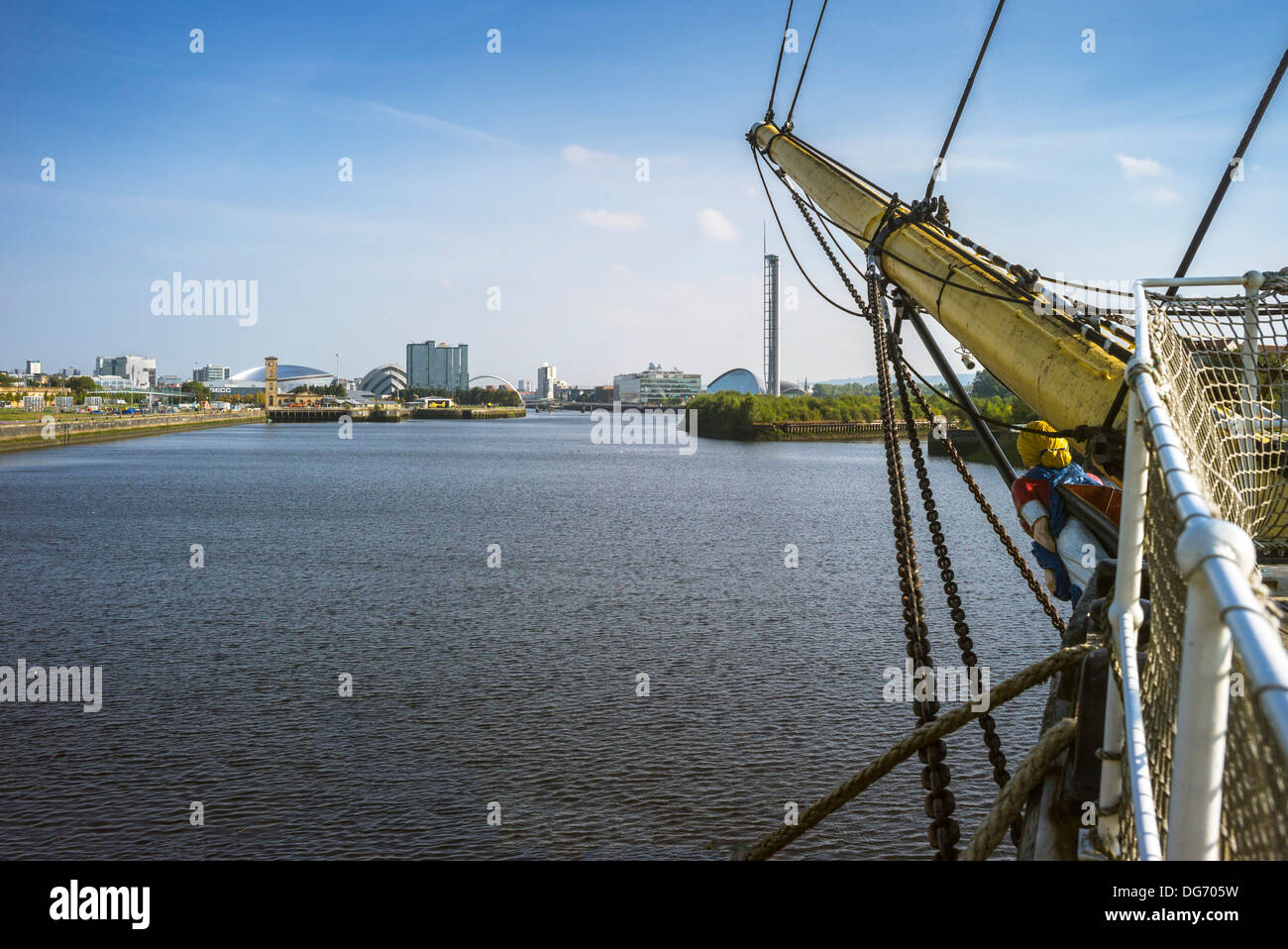 On board the Tall ship Glenlee a view looking along the bowsprit up the river Clyde towards the Glasgow city landmarks. - Stock Image