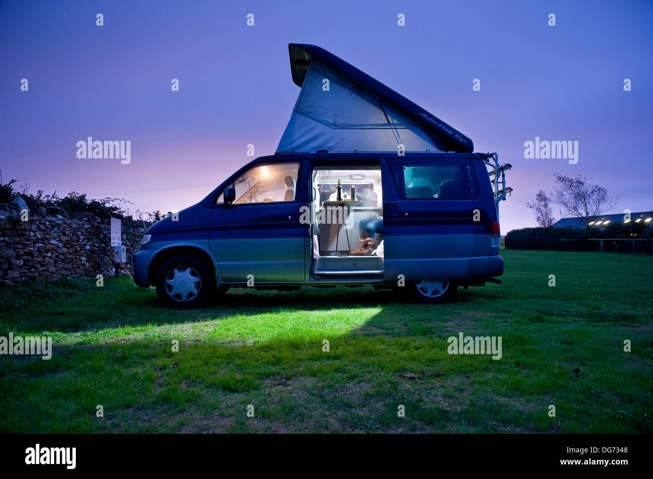 Campervan at twilight on a campsite near Weymouth, Dorset, UK - Stock Image