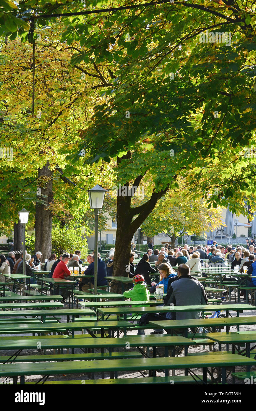 People Relaxing at a Beer Garden in Munich, Gemany - Stock Image