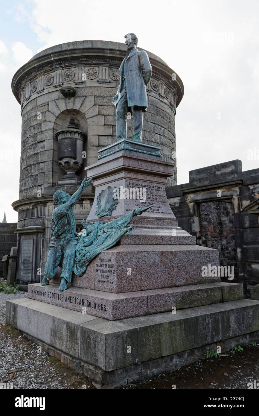 A freed slave depicted reaching to Abraham Lincoln in the Scottish American Soldiers Monument Old Calton Burial Stock Photo
