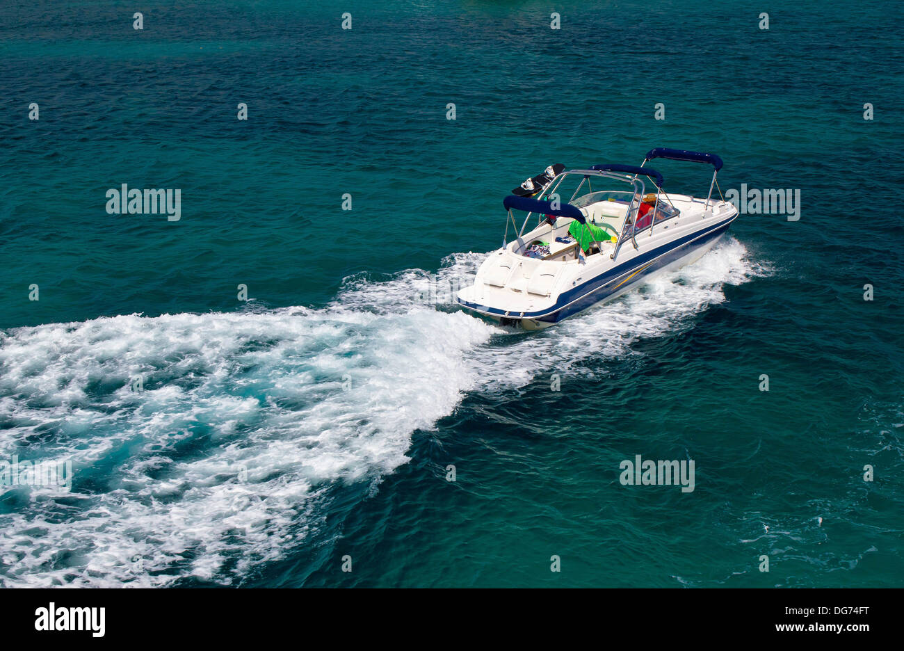 Powerboat on blue open sea water - Stock Image