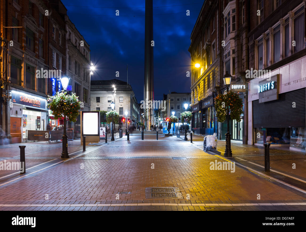 Talbot Street in Dublin city centre with the Spire monument in the background - Stock Image