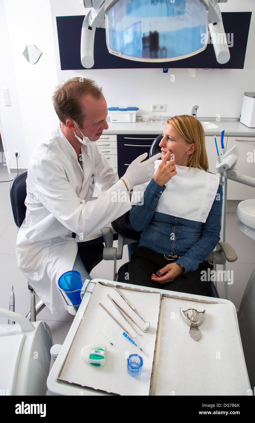 Dental practice, dentistry. Woman at a dentist treatment. - Stock Image
