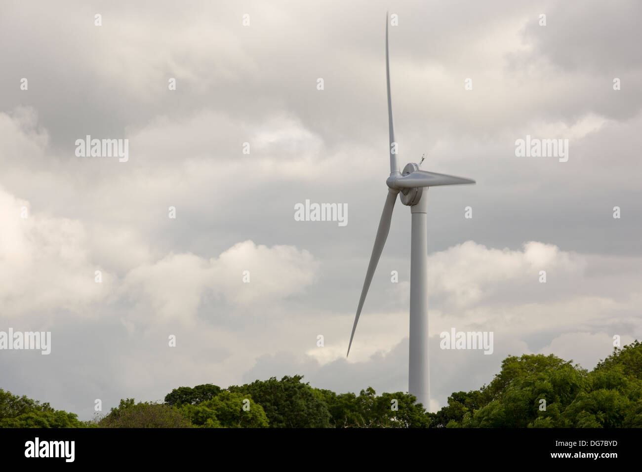 A 500 Kw wind turbine at Back Lane quarry, used to power the quarry operations, near Carnforth, Lancashire, UK. - Stock Image