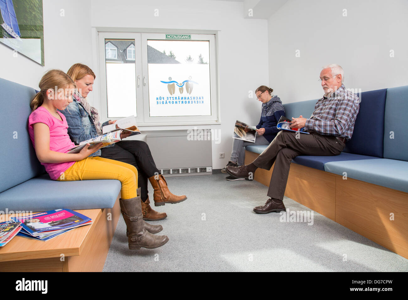 Dental Practice Patients In The Waiting Room Stock Photo