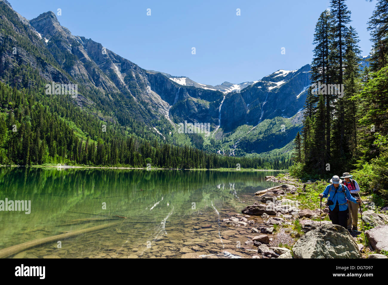 Hikers on the shore of Avalanche Lake, Glacier National Park, Montana, USA - Stock Image