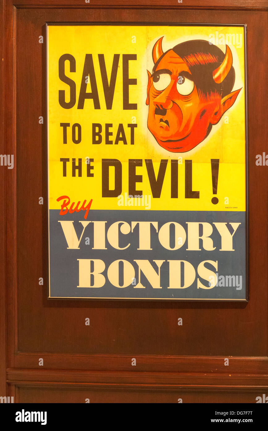 Old Victory Bonds poster with Adolph Hitler as the devil, - Stock Image