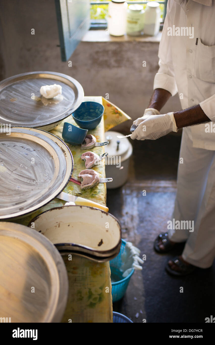 Making Denture Moulds in the Sri Sathya Sai Baba mobile outreach hospital Dentist clinic in a rural village school. Andhra Pradesh, India - Stock Image
